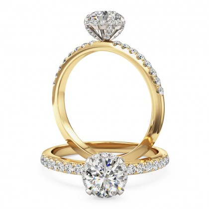 A stylish round brilliant cut diamond halo ring with shoulder stones in 18ct yellow & white gold