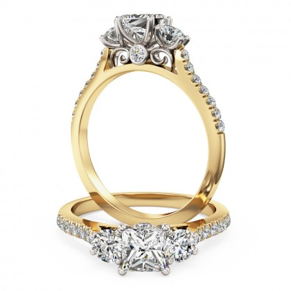 A stunning 3 stone diamond ring with shoulder stones in 18ct yellow & white gold