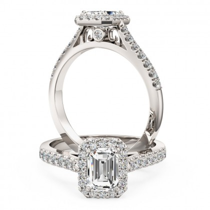 A stunning emerald cut diamond halo with shoulder stones in platinum