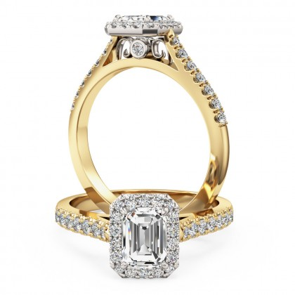 A stunning emerald cut diamond halo with shoulder stones in 18ct yellow & white gold