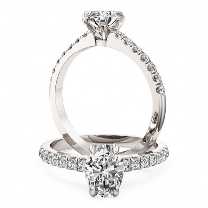 A stunning Oval cut diamond ring with shoulder stones in platinum