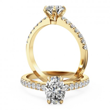 A stunning oval cut diamond ring with shoulder stones in 18ct yellow gold