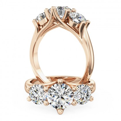 A stunning Round Brilliant Cut three stone diamond ring in 18ct rose gold