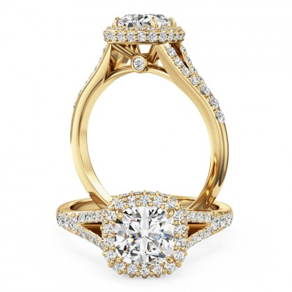 A stunning cushion cut halo style diamond ring with shoulder stones in 18ct yellow gold