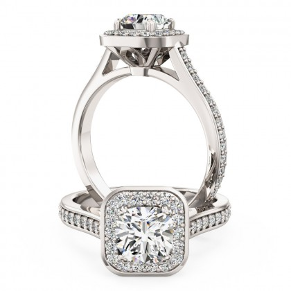 A beautiful Cushion Cut halo style diamond ring with shoulder stones in platinum