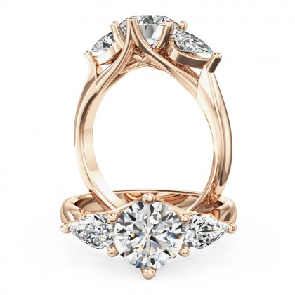A beautiful round brilliant cut diamond ring with pear side stones in 18ct rose gold
