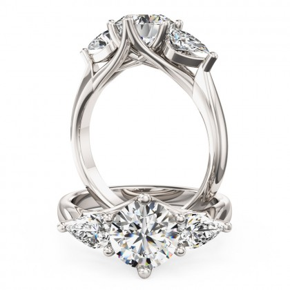 A beautiful round brilliant cut diamond ring with pear side stones in 18ct white gold