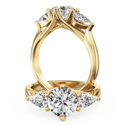 A beautiful round brilliant cut diamond ring with pear side stones in 18ct yellow gold