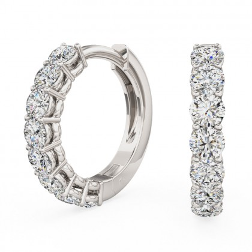 A beautiful pair of brilliant cut diamond huggie earrings in 18ct white gold