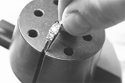 A diamond ring in a clamp