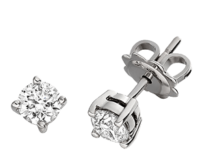 A pair of diamond stud earrings in white gold