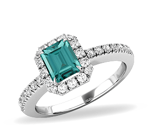 A limited edition emerald cut green tourmaline and diamond ring in white gold